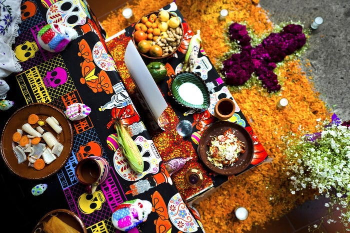 Food offerings are placed at the altar of the dead, a religious site honoring the deceased, on Nov. 1, 2014, in Morelia, Mexico.