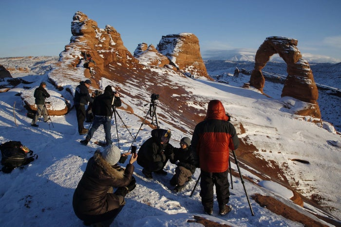 Photographers at Delicate Arch in Arches National Park on Dec. 31, 2010.