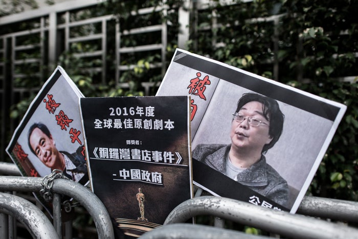 Gui Minhai, shown on the placard on the right, was detained in 2015.