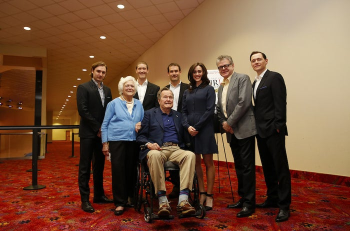 Former President George H.W. Bush, center, former first lady Barbara Bush, second from the left, and the cast of AMC's new series TURN attend a private screening on Saturday, March, 29, 2014 in Houston, Texas.
