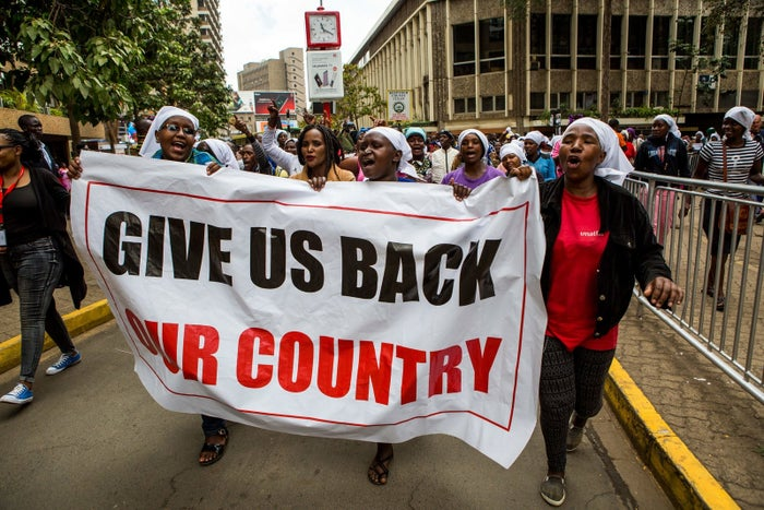Supporters of the ruling party demonstrate in Nairobi after the Supreme Court said it couldn't make a decision on delaying the vote.