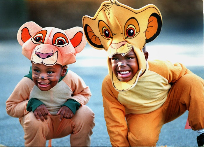 At the annual Zoo Howl at the Franklin Park Zoo in Boston, Aliyha Alleyne (left), age 3, and Kadeem Dixon, age 5, wait to be judged for best costume on Oct. 31, 1998.