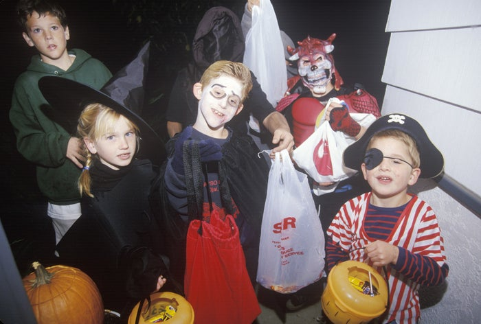 Costumed children go trick-or-tricking in Oak View, California, on Oct. 31, 1996.