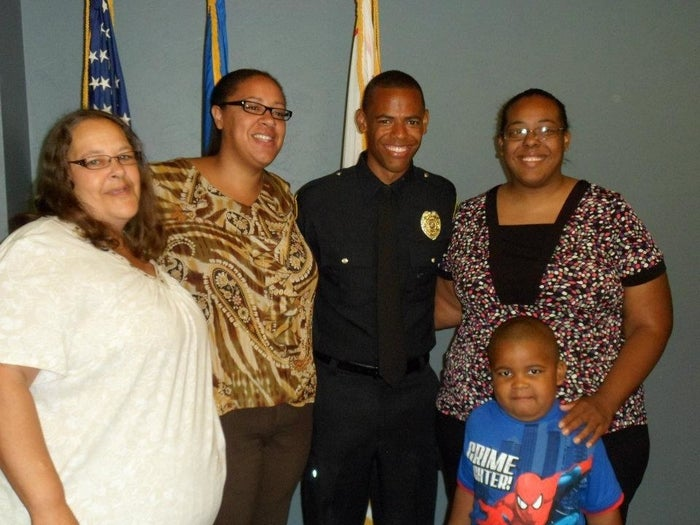 Robinson with his family in 2014, after becoming an officer