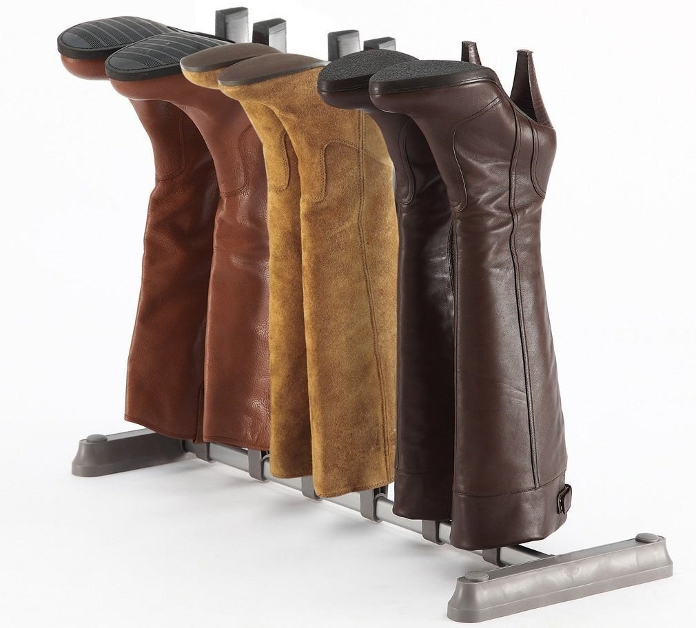 """Promising Review: """"I needed something to organize my boots. I have been putting them at the bottom of my closet but they flop and fall over. This boot organizer works well. I put it together very quickly. It fits under the hanging shirts in my closet. I am planning to buy more because I have more than three pairs of boots. I just wanted to try one out first. It works for me."""" —AndreaGet it from Amazon for $18.99."""