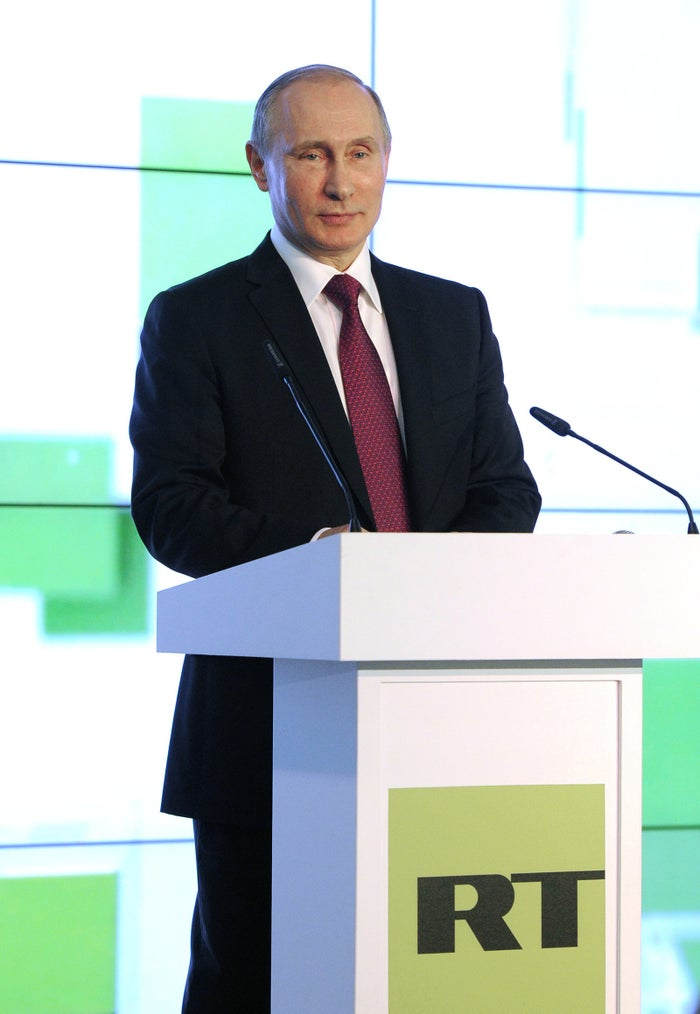 Putin speaking at an RT event in 2015.