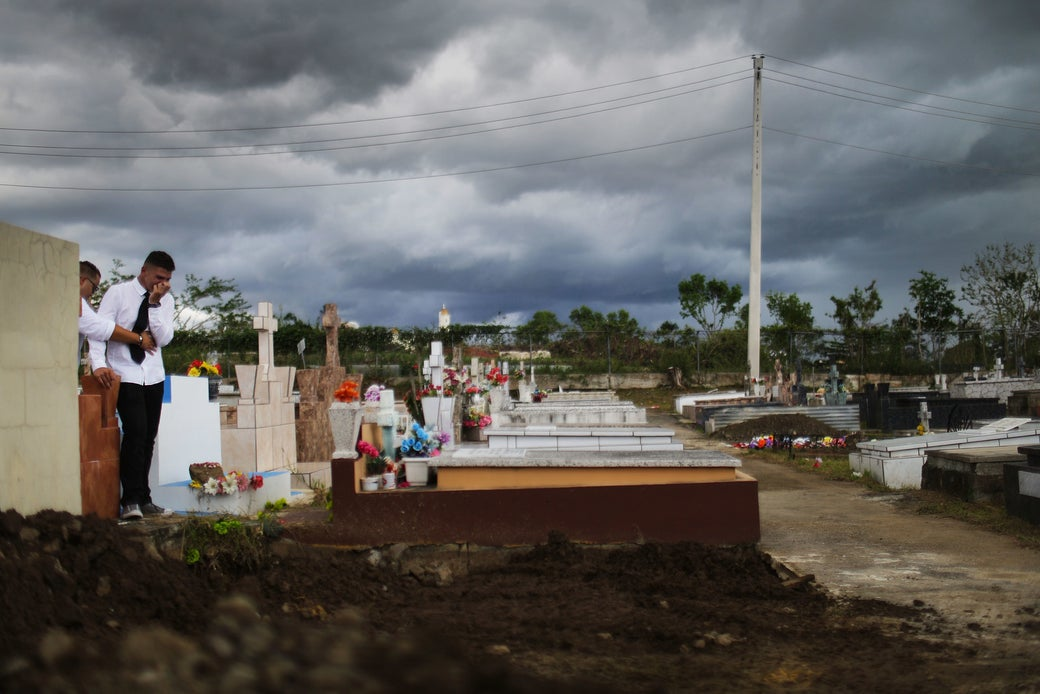 A mourner stands after the burial ceremony in Puerto Rico on Oct. 14.