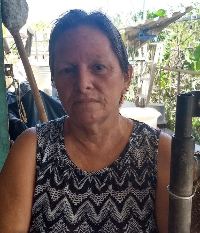 Blanca Alvarez outside her home in Aguadilla.