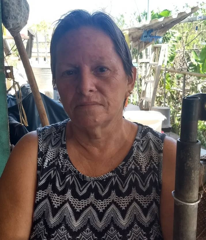 Blanca Alvarez outside her home in Aguadilla.