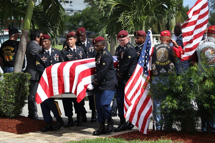 U.S. military honor guard carries the casket of U.S. Army Sgt. La David Johnson during his burial service at the Memorial Gardens East cemetery on Oct. 21, 2017, in Hollywood, Florida.