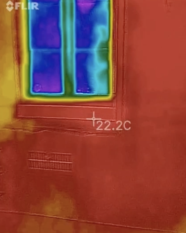 And despite it being a relatively chilly night, the thermal sensor somehow detected a weird amount of heat in the wall near them.