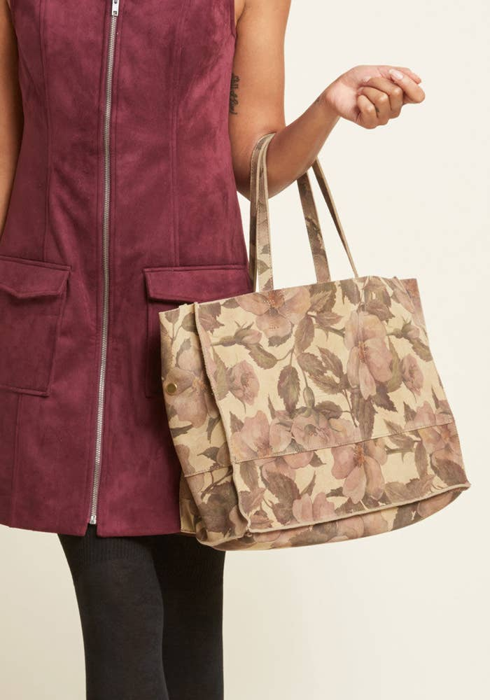 899332c4ce7eaf This floral suede tote you can use for school or work without having to  compromise style.