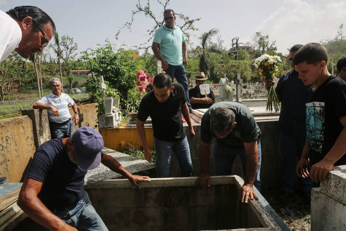 Mourners and cemetery workers in Utuado, Puerto Rico, on Oct. 19.