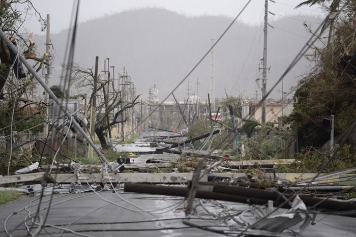 Electricity poles and lines lay toppled on the road after Hurricane Maria hit Humacao, Puerto Rico.