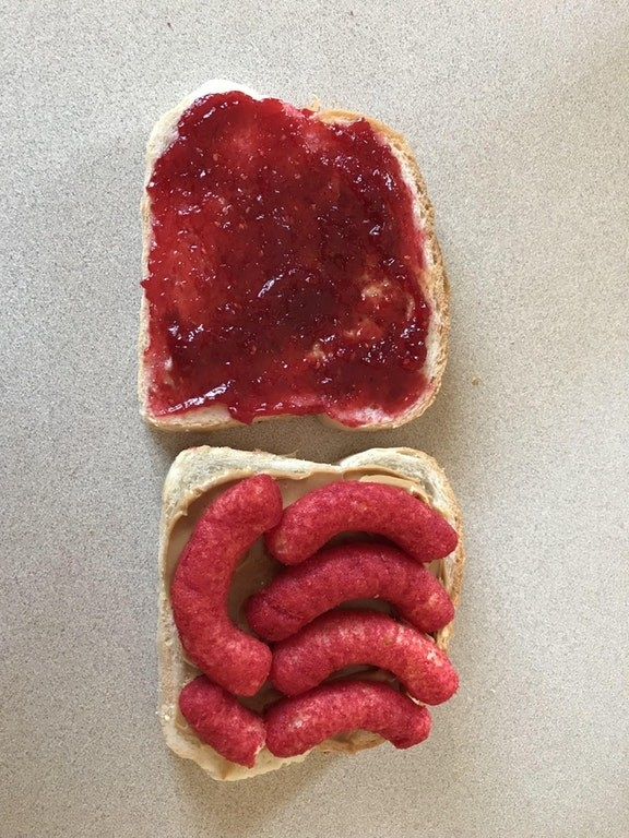 This peanut butter and jelly sandwich with Flaming Hot Cheeto puffs which will get stuck to the roof of your mouth AND get stuck in your teeth.