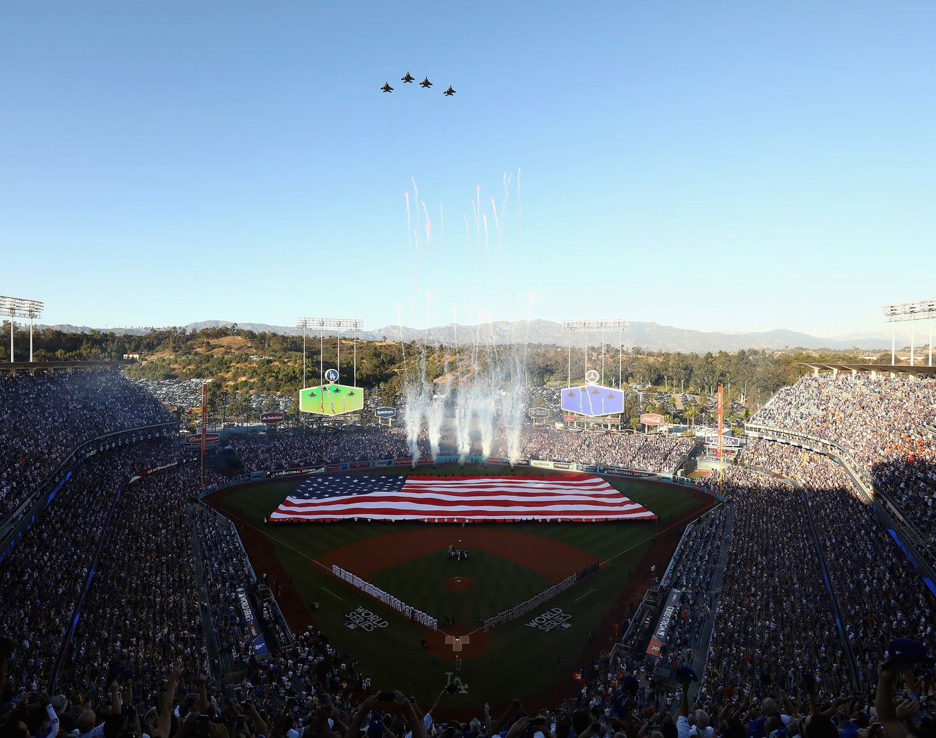 Military aircraft perform a flyover before Game 1 of the 2017 World Series between the Houston Astros and the Los Angeles Dodgers at Dodger Stadium on Oct. 24.