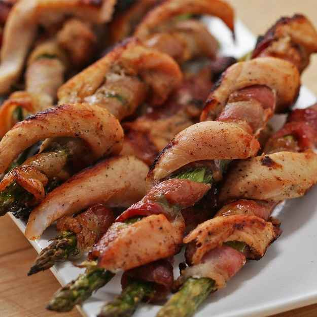 12 servingsINGREDIENTS2  boneless, skinless chicken breast1 teaspoon salt, divided1/2 teaspoon pepper1 teaspoon onion powder1 teaspoon garlic powder6 tablespoons lemon juice, divided6 strips bacon12 stalks asparagus, ends trimmed285 g (1 cup) greek yogurt3 tablespoons  fresh parsley, chopped1 tablespoon fresh dill, choppedPREPARATION1. Preheat oven to 400˚F (200˚C).2. On a cutting board, slice chicken lengthwise into 1-inch (2 cm) thick slices. Take each slice of chicken and cut it in half lengthwise leaving about 1 inch (2 cm) uncut on one end of the strip.3. Cut off part of the uncut end of the chicken so you do not have a thick spot in the middle of your longer chicken strip.4. Place chicken strips in a bowl. Add ½ teaspoon salt, pepper, onion powder, garlic powder, and 3 tablespoons lemon juice and mix to combine.5. Transfer to the refrigerator.6. On a cutting board, slice each piece of bacon lengthwise creating 12 strips in total.7. Wrap the cut strip of bacon around the asparagus.8. Wrap a marinated chicken strip around the bacon-wrapped asparagus. Repeat with remaining ingredients.9. Place each bacon chicken asparagus twist on a parchment paper-lined baking sheet.10. Bake for 10 minutes.11. Turn up the heat to broil, and broil for 10 minutes. Flip the twists over, and broil for an additional ten minutes.12. In a bowl add the Greek yogurt parsley, dill, ½ teaspoon salt, and 3 tablespoons lemon juice. Stir until well combined.13. Remove bacon asparagus twists from baking sheet, and let cool. Serve with herb yogurt dipping sauce.14. Enjoy!Inspired by:https://www.facebook.com/buzzfeedtasty/videos/2042402879345684/