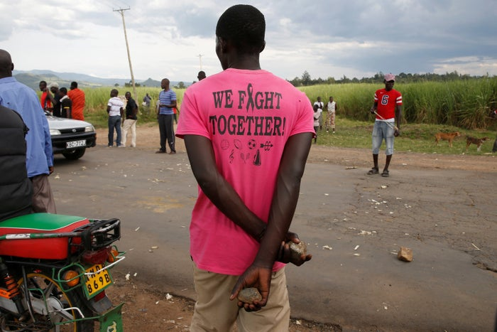 A member of the Luo ethnic group holds rocks after a standoff with members of the Kalenjin ethnic group in Kisumu.