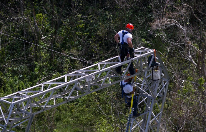 Whitefish Energy workers work on power line towers in Barceloneta, Puerto Rico, on Oct. 15, 2017.