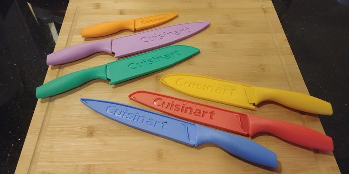 "When I first discovered this rainbow knife set that sells for about $20 on Amazon, the classically trained chef in me was skeptical they'd live up to the hype of 3,000+ five-star reviews. But then I realized they were made by Cuisinart, a brand I've pretty much always had positive experiences with in the past. So I picked up a set to serve as backup to the fancy German knives I've been using since they were issued to me in culinary school over a decade ago.The shockingly inexpensive set gives you six of the most useful knives you could ever ask for — including an 8-inch chef knife, 8-inch serrated bread knife, 8-inch slicing knife, 7-inch santoku knife (the Japanese version of a chef knife), 6.5-inch serrated utility knife, and 3.5-inch paring knife, along with matching protective guards for each one. (There's also a ""jewel""-colored version of the set, with dulled-down hues for anyone who might want less of a pop in their kitchen gear.)"