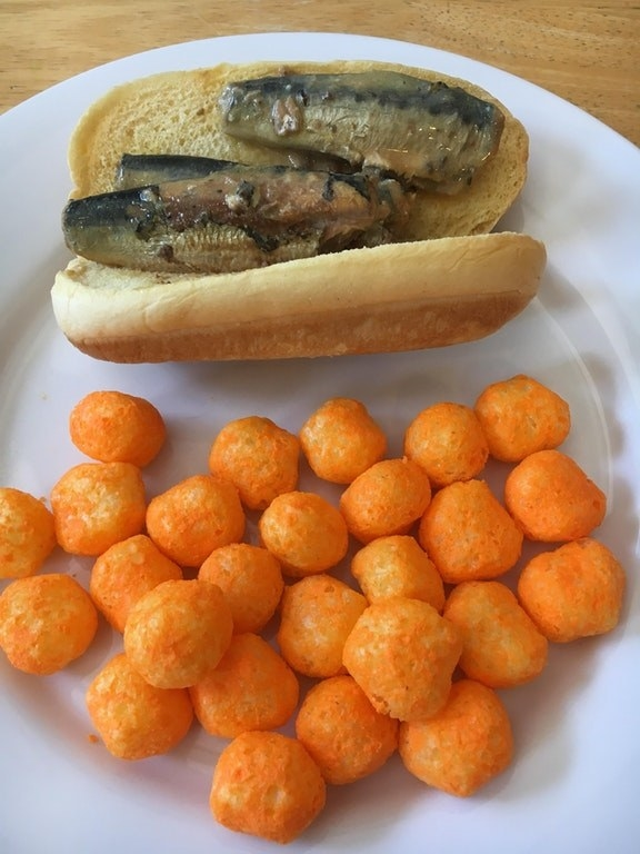 "This cold, wet, pescatarian ""hot dog"" with cheeseballs for some reason:"