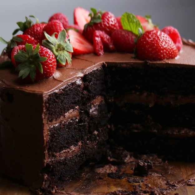 12 servingsINGREDIENTSCake185 g (1 1/2 cups) flour120 g (1 cup) dutch  processed cocoa powder1 teaspoon salt1 1/2 teaspoons baking soda1/2 teaspoon baking powder355 mL (1 1/2 cups) stout1 tablespoon vanilla extract1 tablespoon espresso powder230 g (1 cup) butter300 g (1 1/2 cups) sugar3  egg115 g (1/2 cup) mayonnaise115 g (4 oz) dark chocolate, choppedButtercream345 g (1 1/2 cups) butter, softened1 tablespoon vanilla extract60 g (1/2 cup) dutch  processed cocoa powder800 g (5 cups) powdered sugar fresh fruit, to decoratePREPARATION1. Preheat oven to 325˚F (160˚C).2. Grease and line three 8-inch (20 cm) cake tins with parchment paper.3. In a large bowl, sift together the flour, cocoa powder, salt, baking soda, and baking powder. Set aside.4. In a large glass measuring cup, combine the stout, vanilla, and espresso powder. Set aside.5. In a large mixing bowl, cream together the butter and sugar until it is light and fluffy, about 5 minutes, scraping down the sides occasionally to ensure all the ingredients are being evenly creamed together.6. Beat in the eggs, one at a time, ensuring each egg is fully incorporated before adding the next.7. Add the mayonnaise and beat until the mixture is smooth and creamy.8. Alternate adding the prepared dry and wet ingredients to the batter. Starting with about ⅓ of the dry ingredients, beat until incorporated. Then add ⅓ of the liquid ingredients, mixing until the batter comes together. Continue until all the wet and dry ingredients have been incorporated.9. Using a rubber scraper, fold the dark chocolate chunks into the batter.10. Distribute the batter evenly between the 3 prepared cake tins.11. Bake for about 35 minutes, or until a toothpick inserted into the center of the cake comes out clean.12. Place the cakes on a cooling rack and leave to cool for about 10-15 minutes, until the outside of the pan is cool enough to touch.13. Once the cakes have cooled, loosen the edges using a butter knife. Then place a large plate over the tin