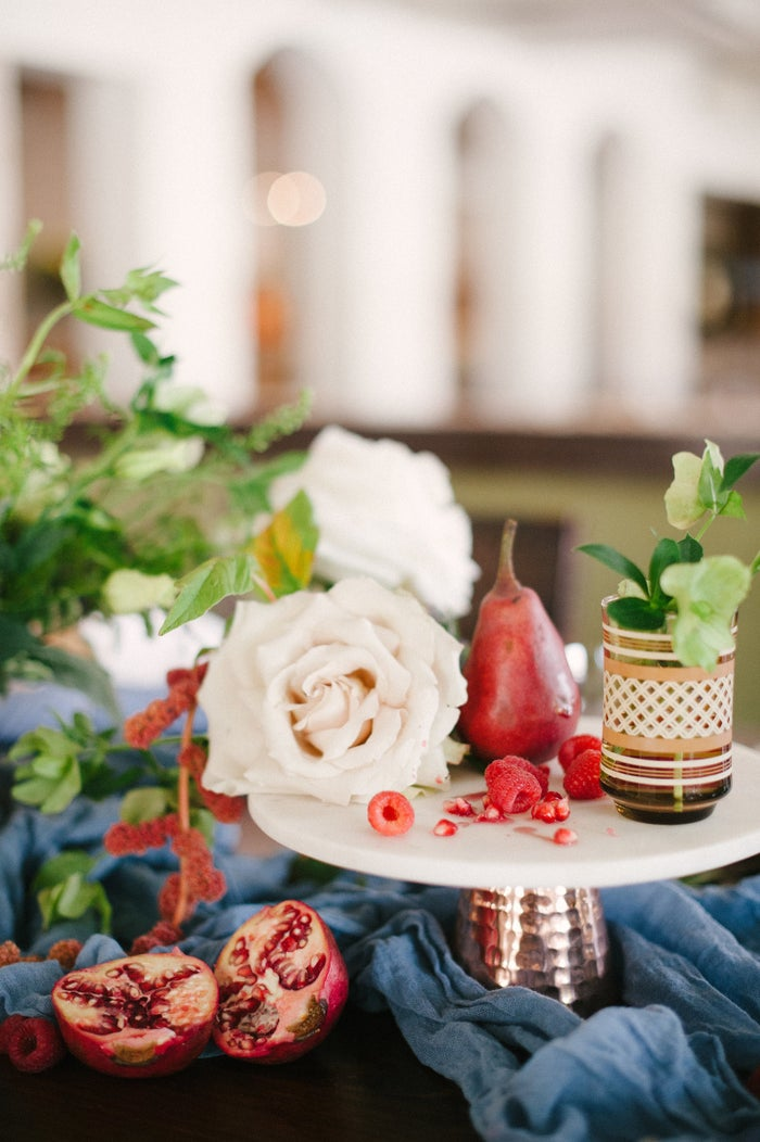 Create a textured tablescape with a combination of soft colors, real fruit and pops of mixed metals. Posh Parties layered beautiful soft blues, cranberry, and gold blend rustic elements with sophisticated details for a picture-perfect fall tablescape.