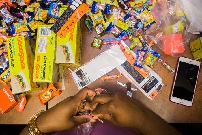 Fortune Academy staff package candy to give away at their annual haunted house in Harlem.