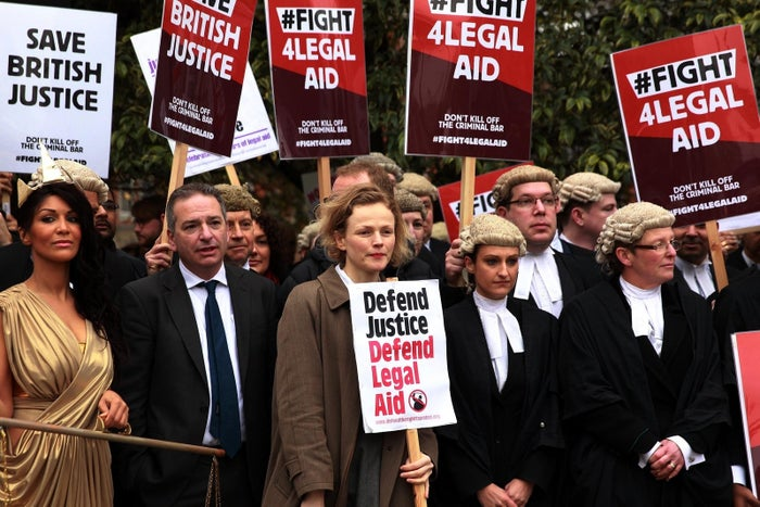Actress Maxine Peake (centre) with protesters outside Westminster in London campaigning against legal aid cuts in 2014.