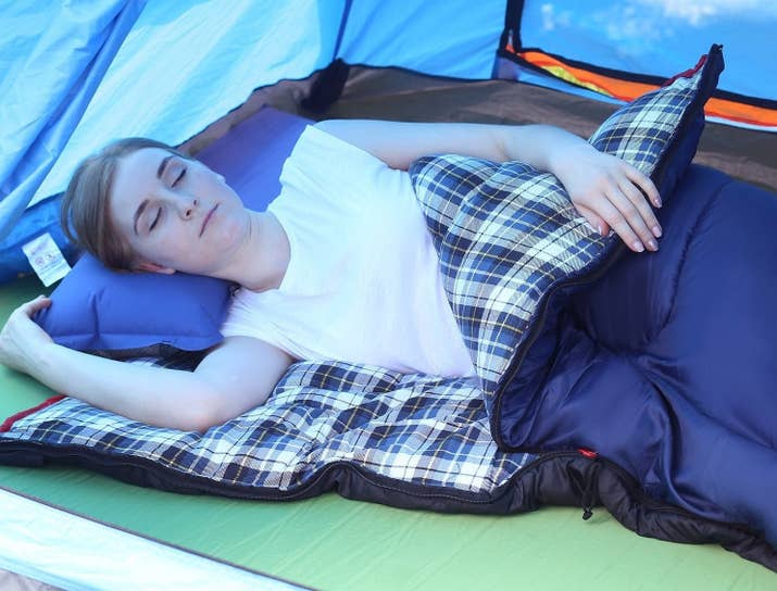"""This sleeping bag opens up to 75""""x33"""" and can fit adults up to six feet tall. The exterior is made of waterproof polyester ripstop fabric, while the inside is lined with cotton flannel. It's suitable to use in a temperature range of 23-41°F but will be most comfortable around 32°F. It can be compressed down to 17""""x8""""x8"""" and weighs around 4.6 lbs. It also comes with a compression sack for storage.Promising review: """"This is the one for me. I bought others that had 'soft lining' that was some weird synthetic thing, and when my rough, old hands touch it, it's like velcro weirdness. I gave the last two bags away because of that. THESE however, actually DO come with a nice, soft cotton flannel. The top of the bag has a drawstring, so you can mummy-bag it, sort of. Nice feature. Zipper seems adequate, the cover is a nice material, and a four-pound bag will more than cover my camping needs. It even came with a very cool carrying bag."""" —ZipparadoPrice: $39.99"""