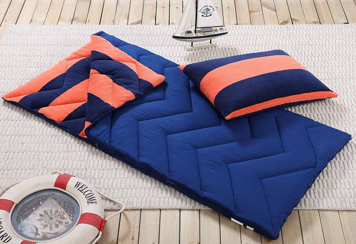 """Each set comes with the sleeping bag (66""""x32"""") and a matching fleece pillowcase (20""""x26""""). The bag is made from microfiber polyester lined with fleece and has straps attached for easy carrying. Everything is machine washable.Promising review: """"The sleeping bag is made well and good quality. It's more of an indoor one. Keeps you warm and comfortable, not paper-thin like some sleeping bags can be. Zipper seems durable enough. My daughter is eight-years-old, and it allows her to use it for a few more years (hopefully). Beautiful colors on the outside and hot pink on the inside. Great deal and my kid loves it!"""" —Kristi LovePrice: $24.99+ (available in seven colors/patterns)"""