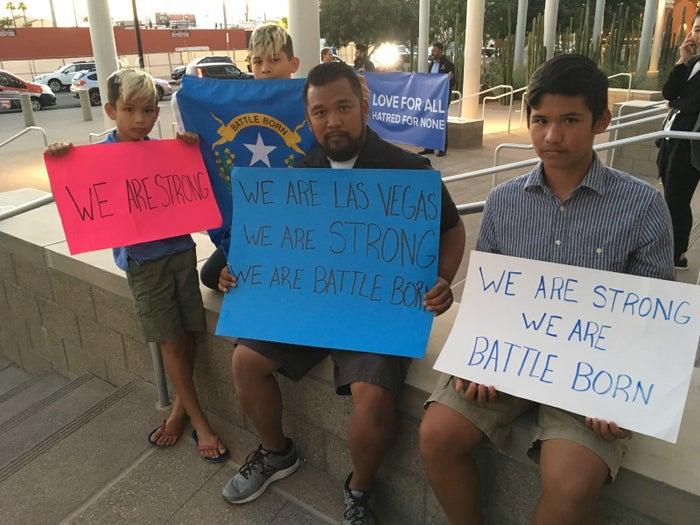 Jon Dimaya, center, at a vigil in Las Vegas.