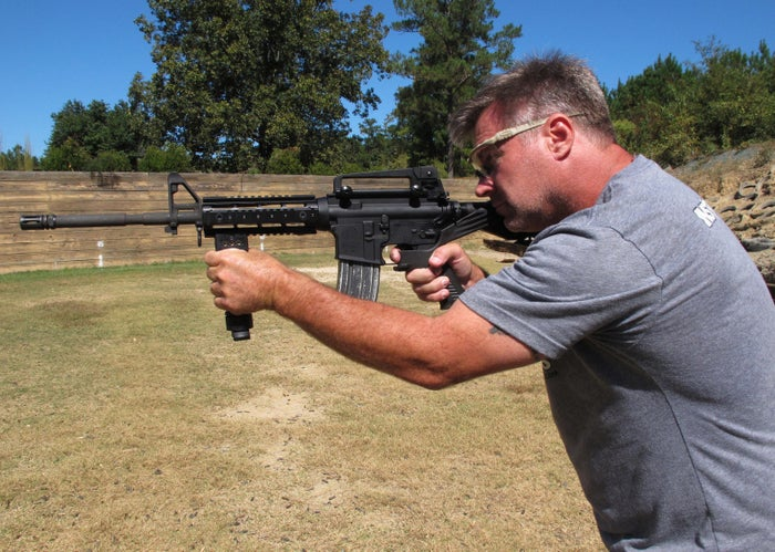 "A shooting instructor aims an AR-15 rifle fitted with a ""bump stock"" on Oct. 4, 2017."