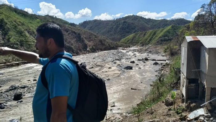 Jose looks out at the river near his home.
