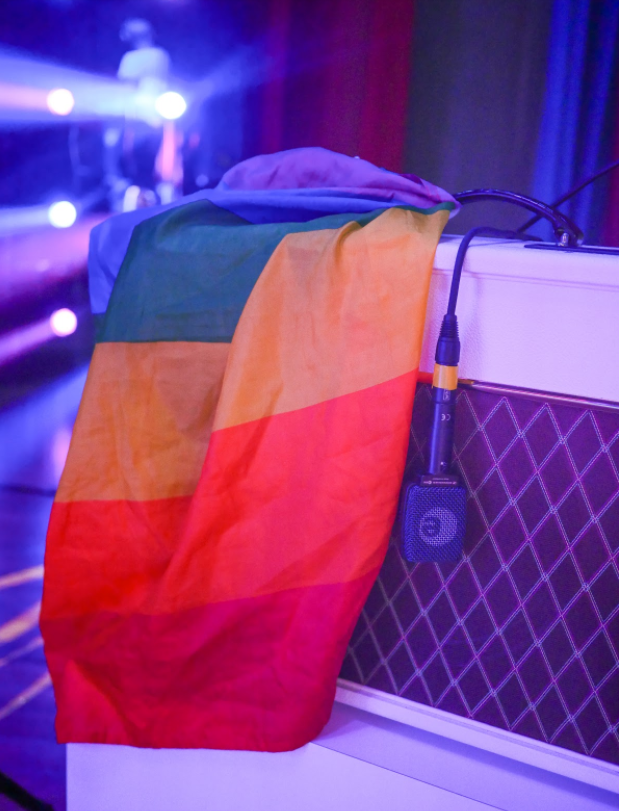 On the first night of my Rainbow tour, a fan threw a rainbow flag onto stage. Now, every night, I keep the flag on my hot pink Vox guitar amp until the end of the show — when I drape myself in it.
