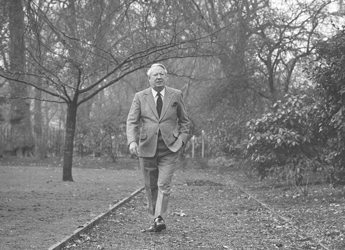 Former prime minister Edward Heath takes a walk near his London home in 1985 on the anniversary of his 35 years as MP for Bexley.
