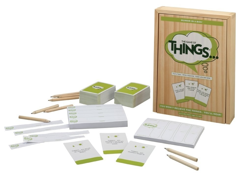 Wooden Game of Things board game box with cards and pencils displayed