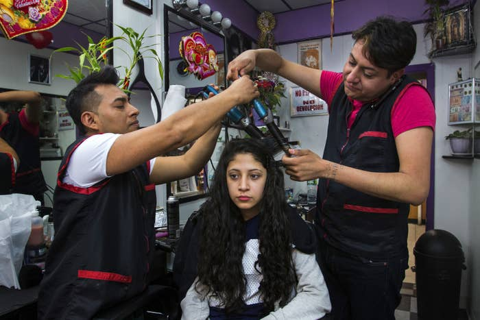 Stephanie Rodriguez has her hair made up at a beauty salon in the Bronx, New York, in March 2014.