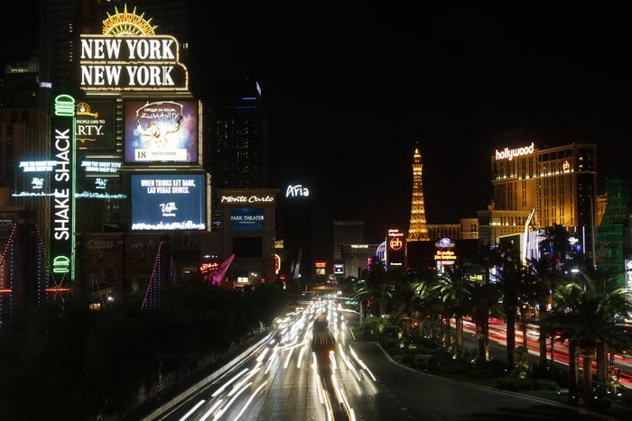 Some of the casinos along the Las Vegas Strip dimmed their marquees signs for about 10 minutes Sunday, Oct. 8, 2017.