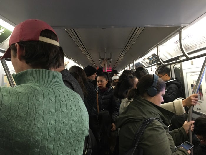 New Yorkers commute from Brooklyn into Manhattan on the N train Wednesday morning, miles from the scene.