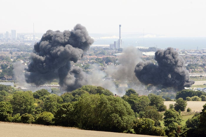 Smoke rises from the scene of the Hawker Hunter jet crash on August 22, 2015 in Shoreham, West Sussex, England.