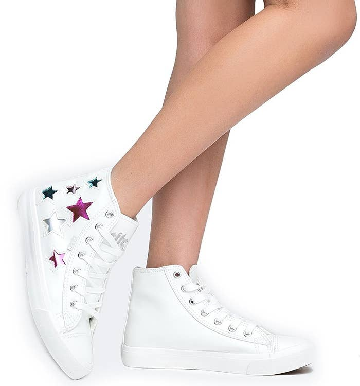 8c9f39cebd48 Metallic star-studded high-top sneakers made of a breathable canvas and  vegan leather.