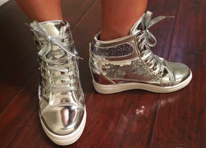 27e8fdc294e7 A pair of hidden wedge metallic sneakers for when you don t want to give up  on your high-heel addiction just yet.