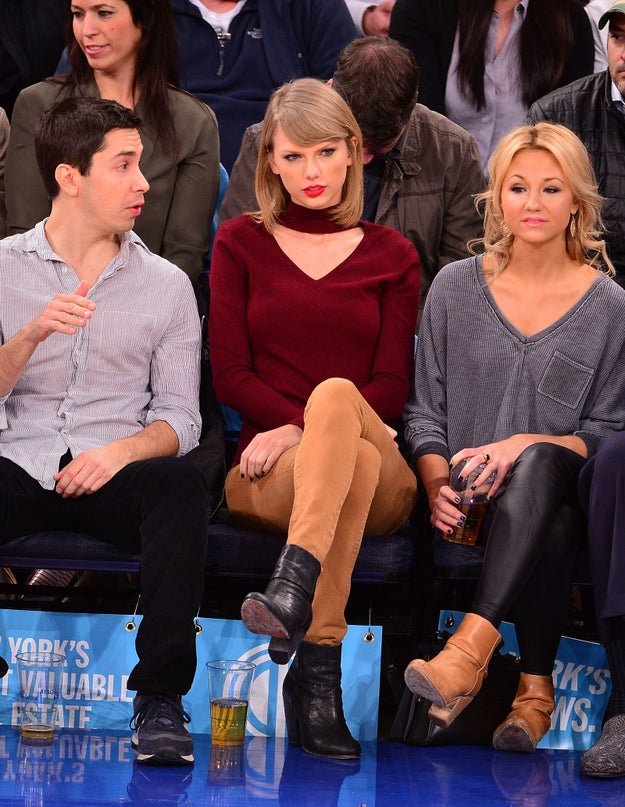 One day in November, aka fall, aka peak Taylor Swift season, she headed out to a basketball game in NYC while wearing a red sweater.