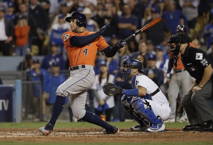 Houston Astros' George Springer hits a two-run home run during the second inning of Game 7.