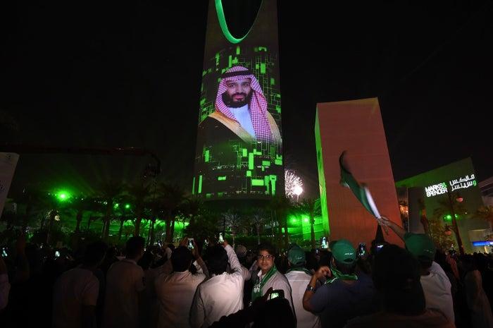 A projection shows a portrait of Crown Prince Mohammed bin Salman in Riyadh.
