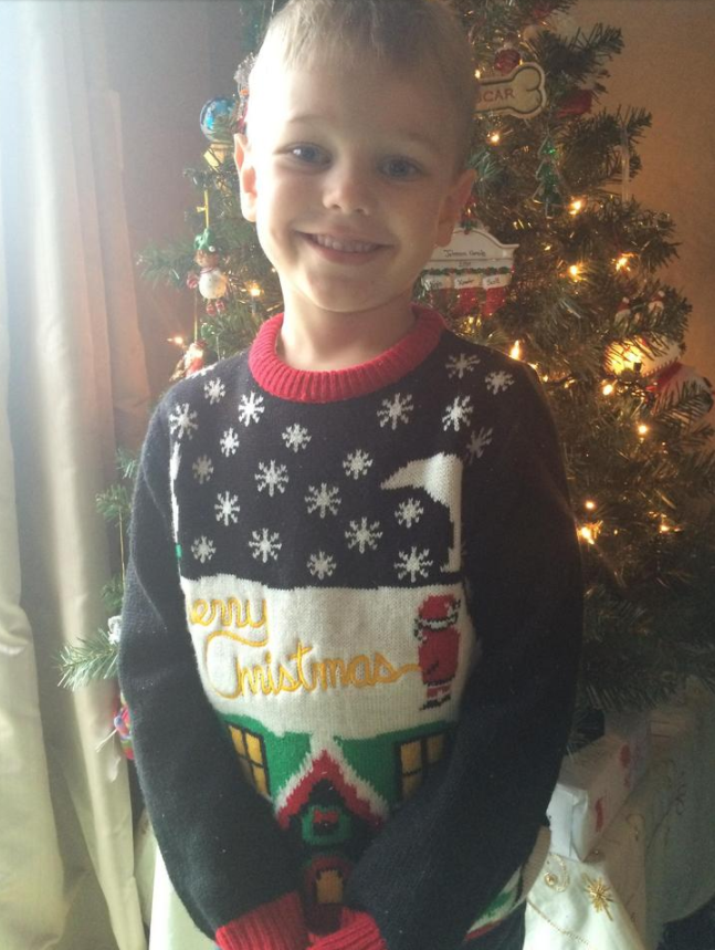 The mom who sent her kindergartener to school wearing this sweater — and didn't realize what Santa was doing on it until his teacher pointed it out at pickup.