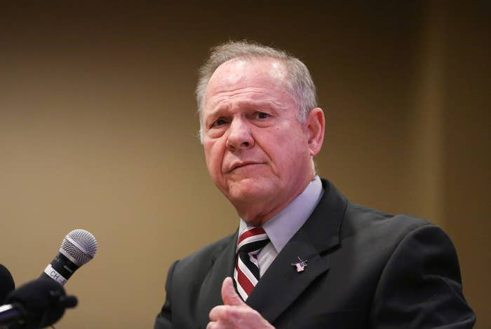 """One woman, Leigh Corfman, told newspaper that in 1979, when she was 14, Moore """"took off her shirt and pants and removed his clothes. He touched her over her bra and underpants, she says, and guided her hand to touch him over his underwear.""""The other women said Moore, who is known for his controversial comments against LGBT people and Muslims, tried to date them when they were between the ages of 16 and 18.Moore has angrily denied the allegations, calling them """"fake news"""" designed to swing the election against him. However, he also said he did not remember whether he had gone on dates with some of the girls. """"If we did go on dates, then we did,"""" he said of one woman who claims she was 17 at the time she dated Moore. On Sunday, Moore threatened to sue the Washington Post over the story containing the allegations, NBC News reported, though he provided no details about when such a suit would be filed. One poll shows the race is now tied between Moore and Democrat Doug Jones to fill the Senate seat that once belonged to Attorney General Jeff Sessions. Many Republicans have said they were seriously troubled by the report, but most have hedged their public statements to say that Moore should step aside """"if"""" the reports are true."""