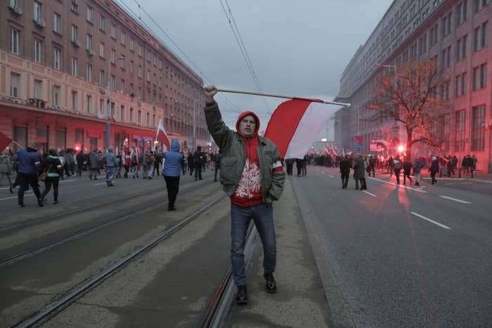Protesters carry Polish flags during a rally organized by far-right, nationalist groups.