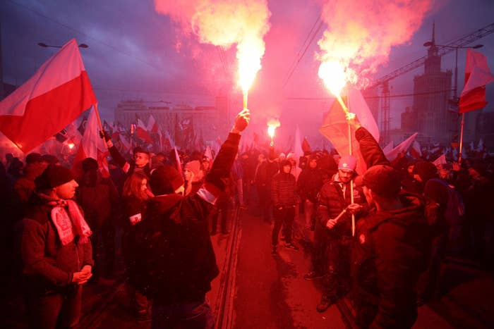 Protesters light flares during a rally organized by far-right, nationalist groups, to mark 99th anniversary of Polish independence in Warsaw, Poland.
